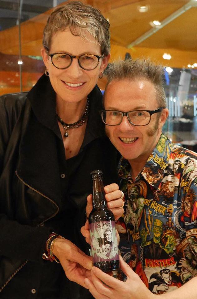 Victoria Price gives her seal of approval to the wicked new brew, Black Cat. Pictured here with the label's designer Graham Humphreys